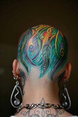 Woman Celebrating Beating Cancer - With a Head Tattoo?